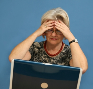 Woman frustrated in front of laptop.