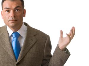 Man raising hands in frustration