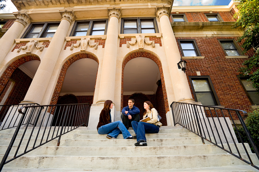Students Sitting on School Building Steps
