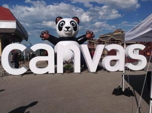 "inflateable panda with ""Canvas"" logo posted outside at InstructureCon 2015"