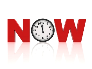 """The word """"now"""" in red block letters with a clock in place of the """"o."""""""