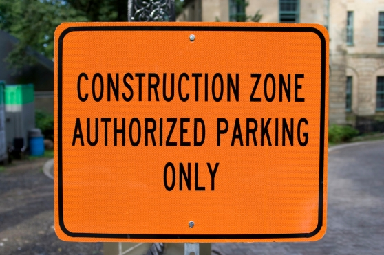 "Sign that reads, ""Construction Zone Authorized Parking Only"""