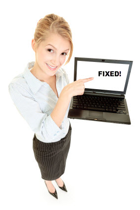 "Woman holding a laptop with a screen that shows the word ""FIXED!"""